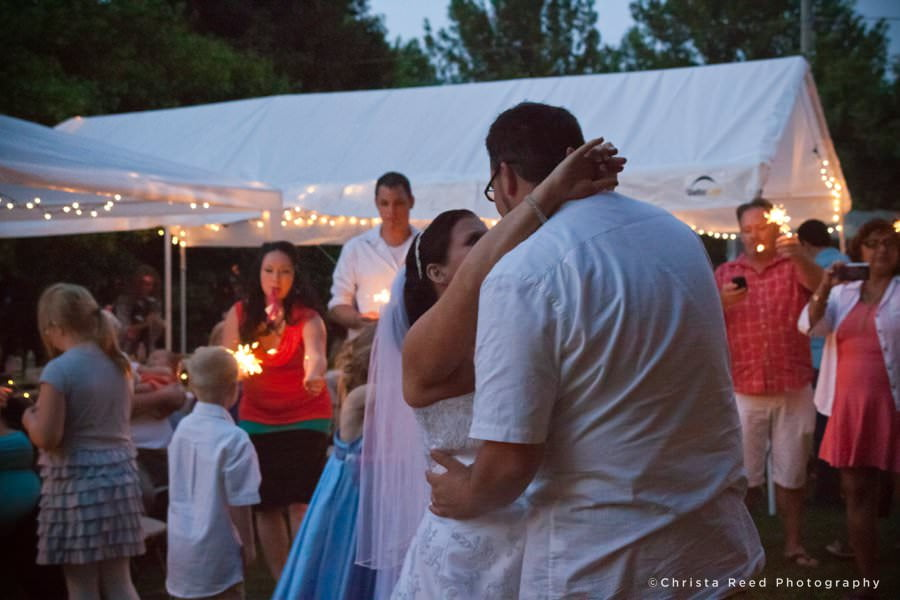 first dance with sparklers for a summer picnic wedding in belle plaine