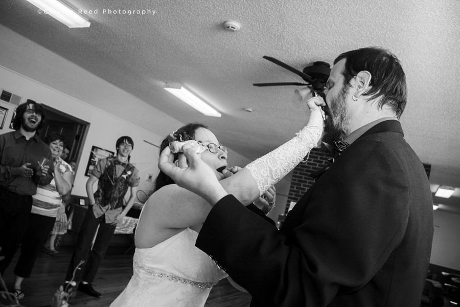 wedding reception with cake smashed in face