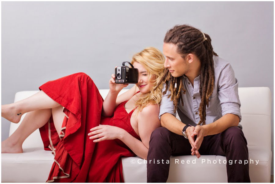 modern engagement inspiration with red dress and camera