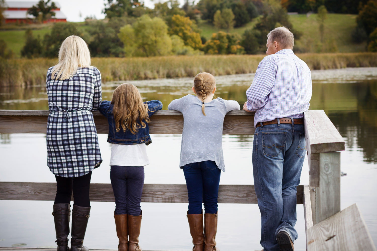 a family on the dock during portraits in minnetrista