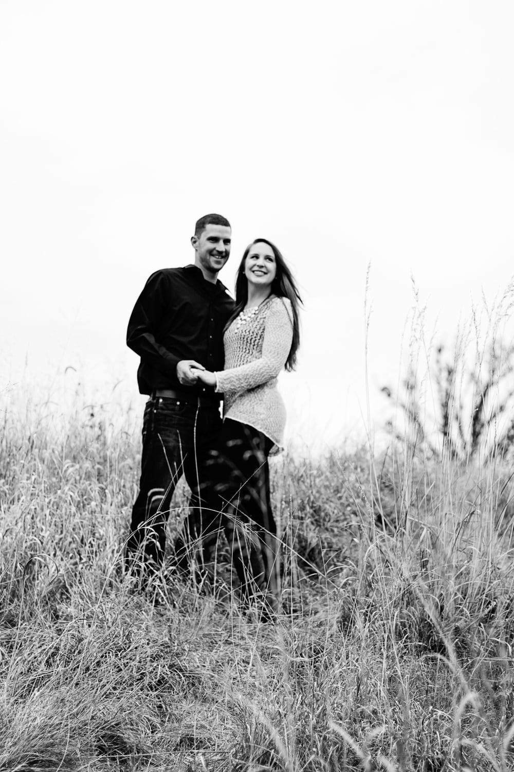 moody black and white outdoor engagement pictures in carver minnesota