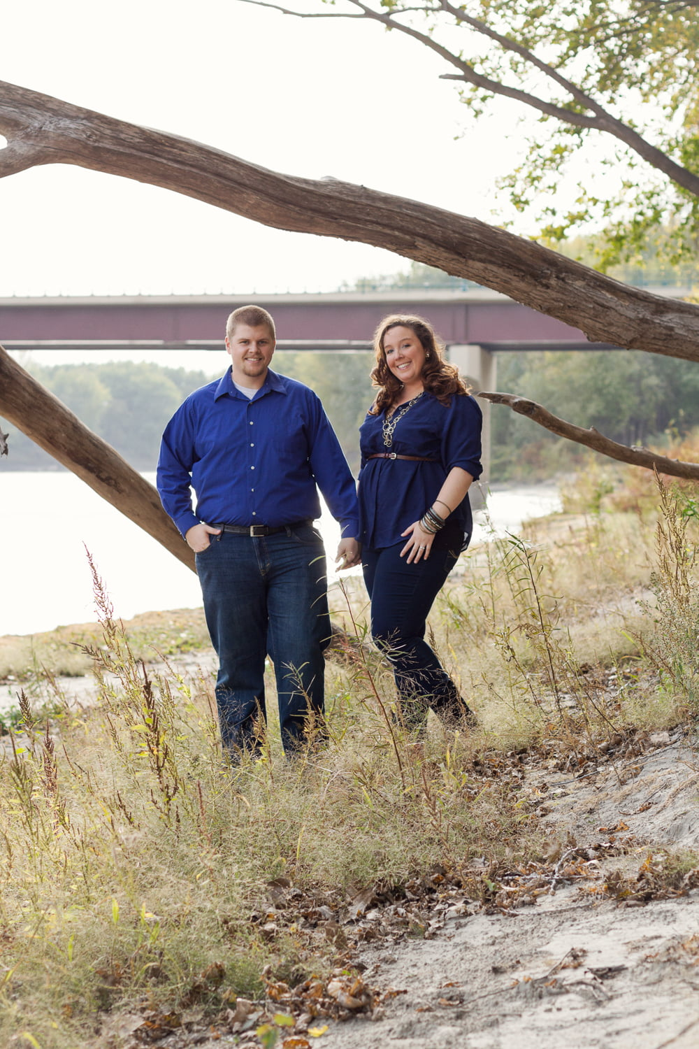 a couple poses for their outdoor engagement pictures in belle plaine mn