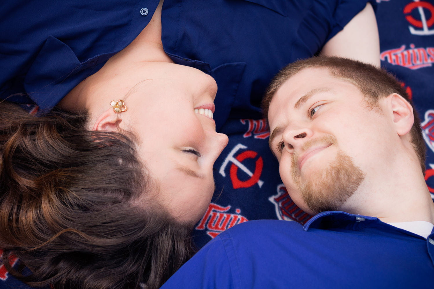 outdoor engagement picture with mn twins gear