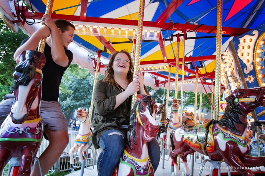 Minnesota State Fair Engagement Photography riding the merry go round.