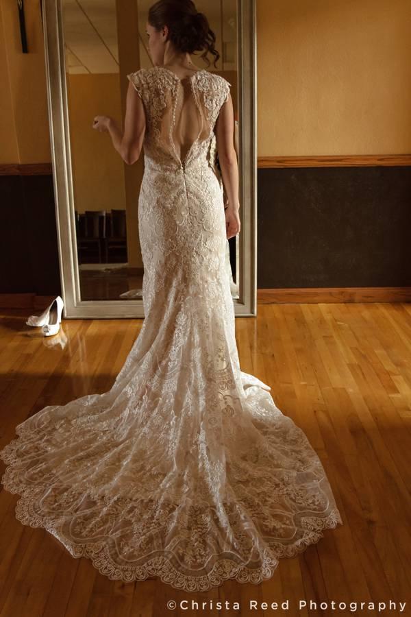 bride with her romantic lace train mankato