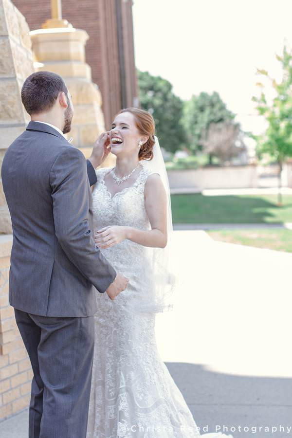 bride laughs with groom at mankato wedding