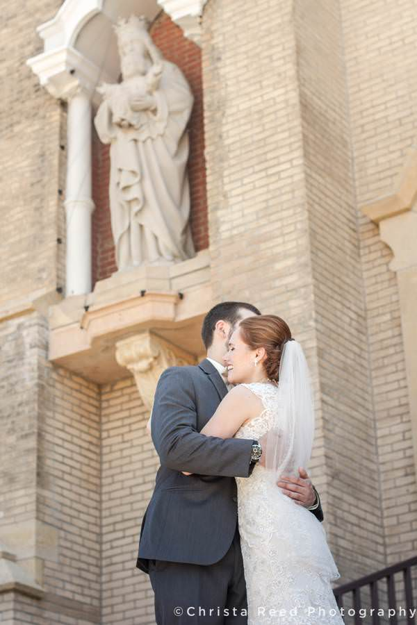 couple hugs in front of church in mankato