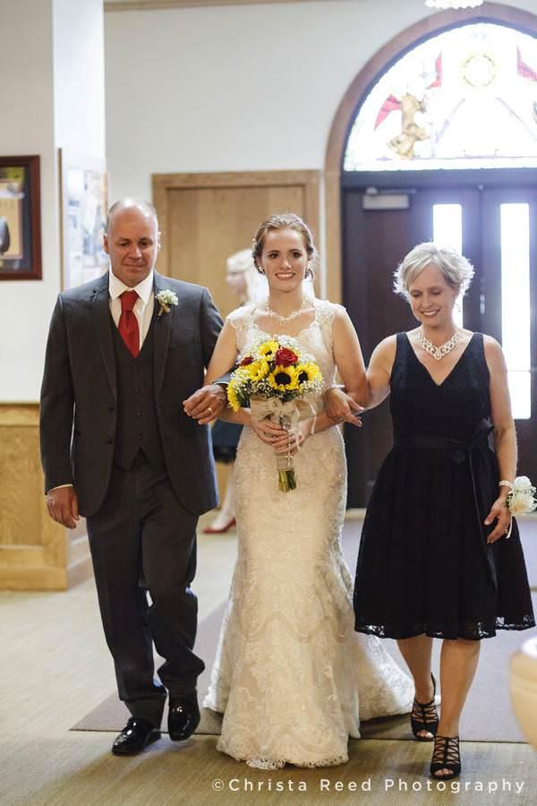 parents walk bride down aisle at mankato catholic wedding