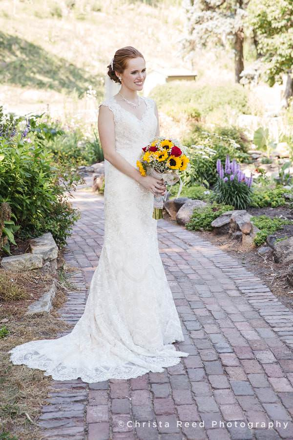 sibley park bridal portrait with lace dress and sunflowers mankato