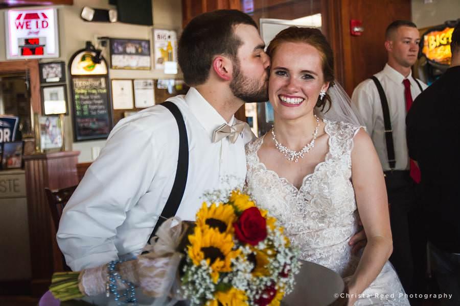groom kissing bride mankato