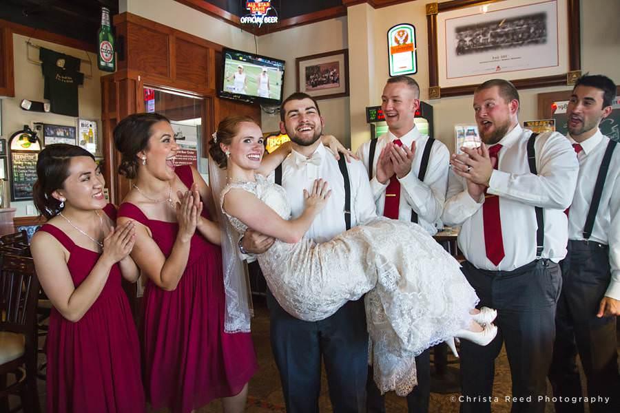 groom holding bride pub500