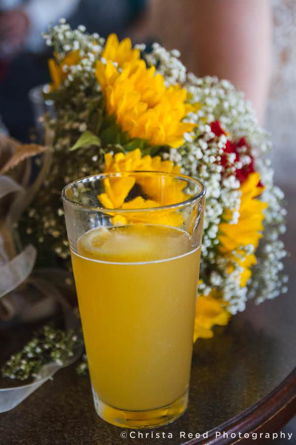 a pint of beer with bridal bouquet at pub500 mankato weddings