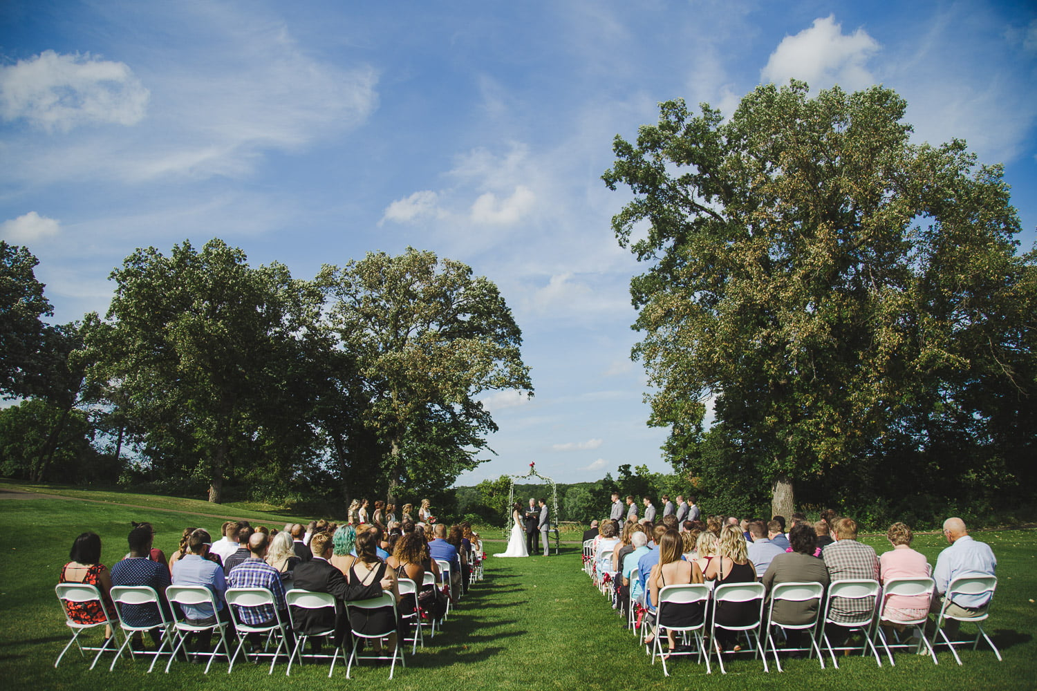 photography of an outdoor wedding ceremony at St. Cloud Country Club