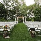 outdoor ceremony in a field surrounded by trees