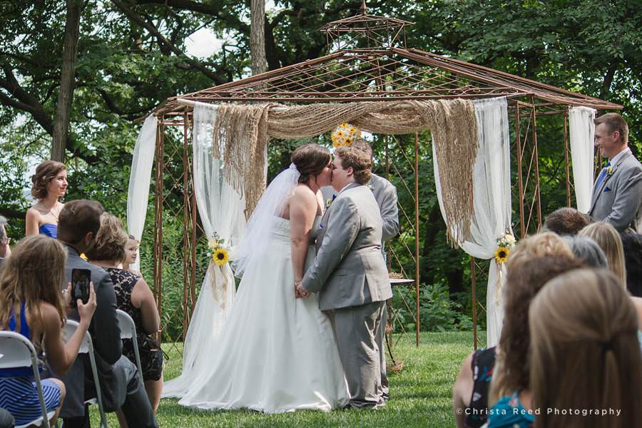 first kiss at chanhassen outdoor wedding