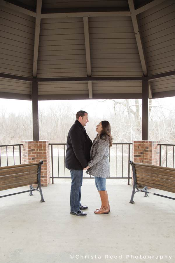 a couple holds hands together for their engagement photos in shakopee