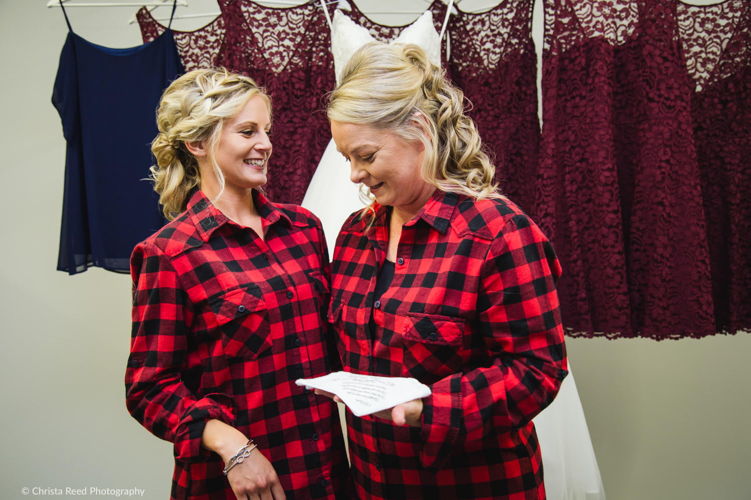 belle plaine minnesota bride gives her mother a gift before the wedding