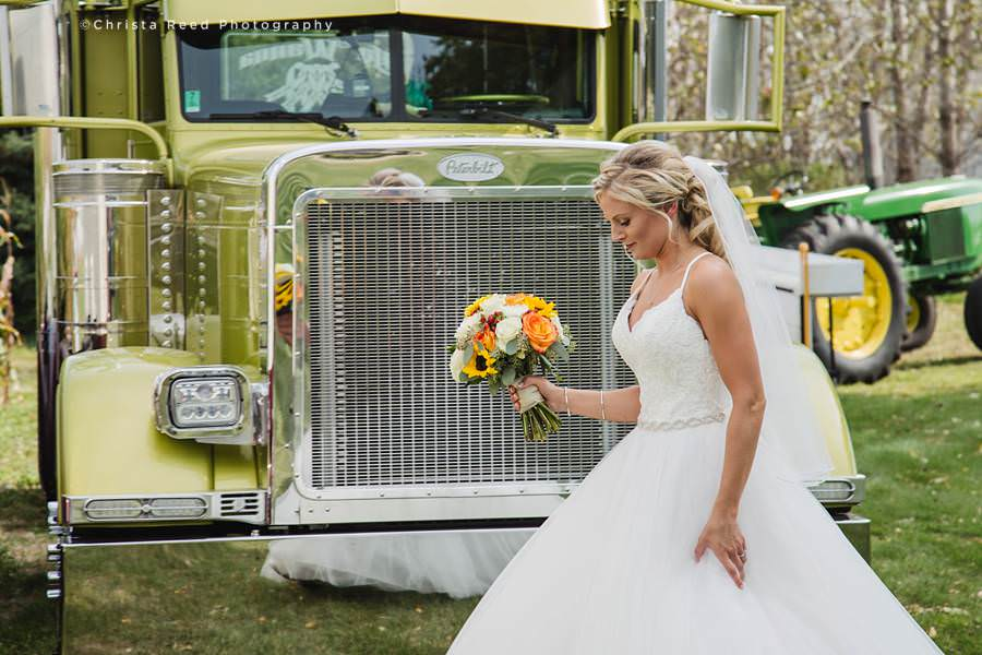 bride and a semi truck for her minnesota wedding