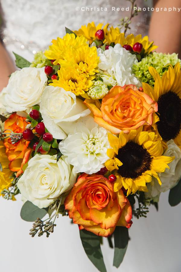 farm wedding in minnesota sunflower bouquet