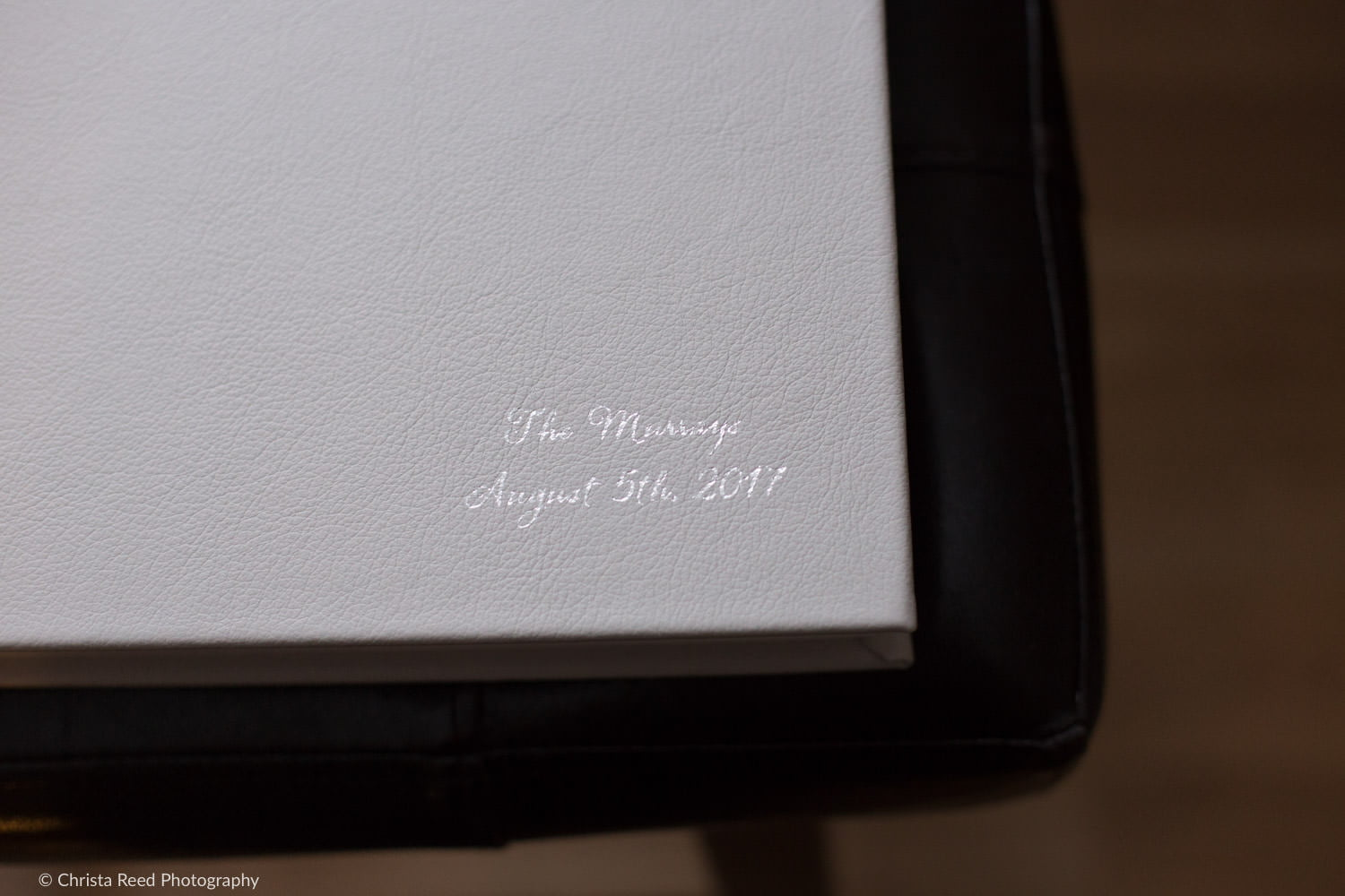 silver and grey wedding album by Minnesota wedding photographer for a chanhassen dinner theatre wedding