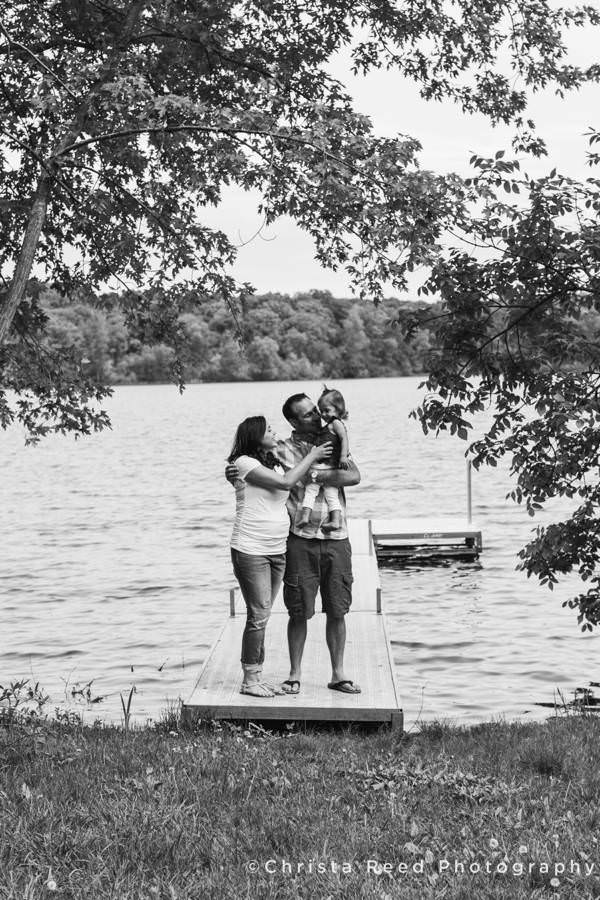maternity photos with family on a lake