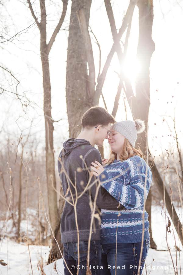 romantic portraits in the tall grass by a river at sunset by Minnesota Couples Photographer