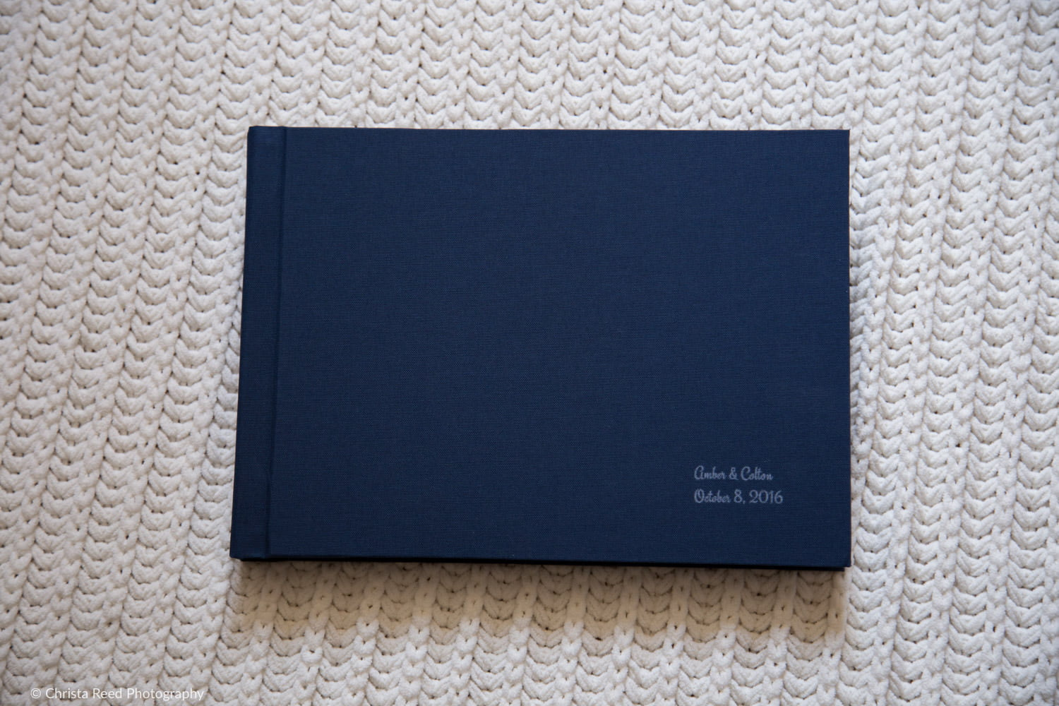 navy blue linen cover of a wedding album by chaska mn wedding photographer