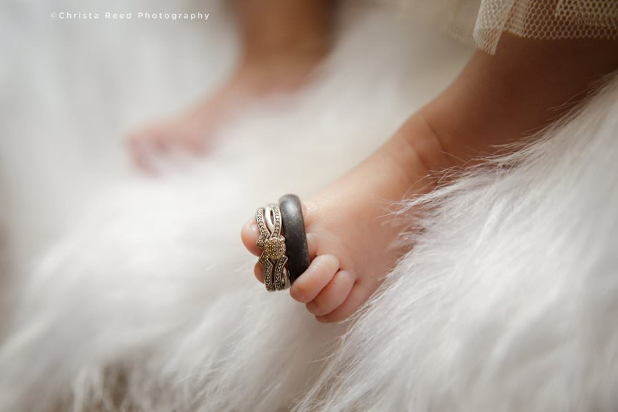 newborn photography with wedding rings