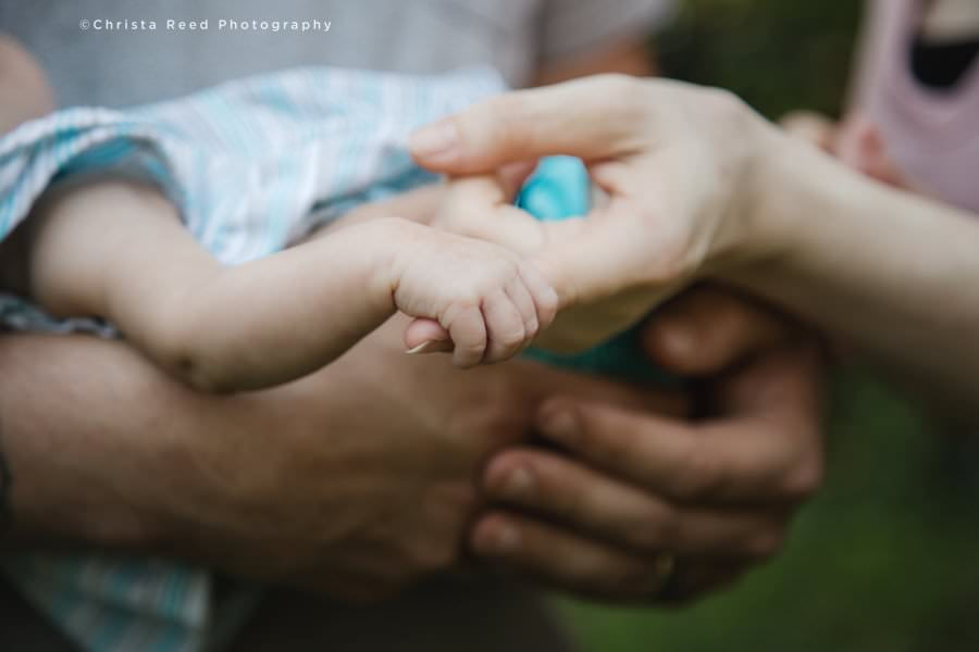tiny baby hands photographed during an in home newborn photography shoot