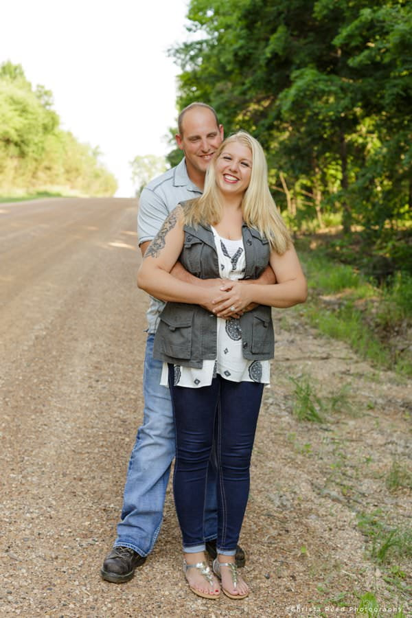 a couple poses for their belle plaine engagement shoot with a professional photographer