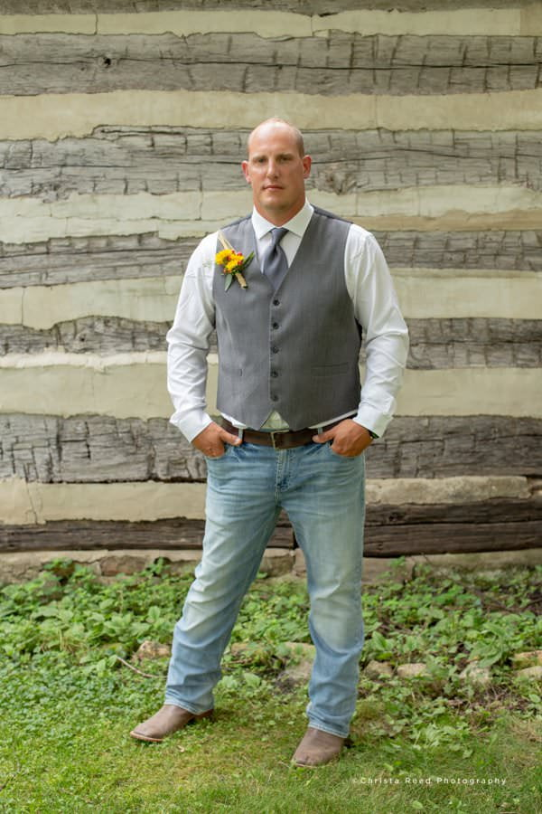 the groom wears jeans and cowboy boots for his Le Sueur Wedding