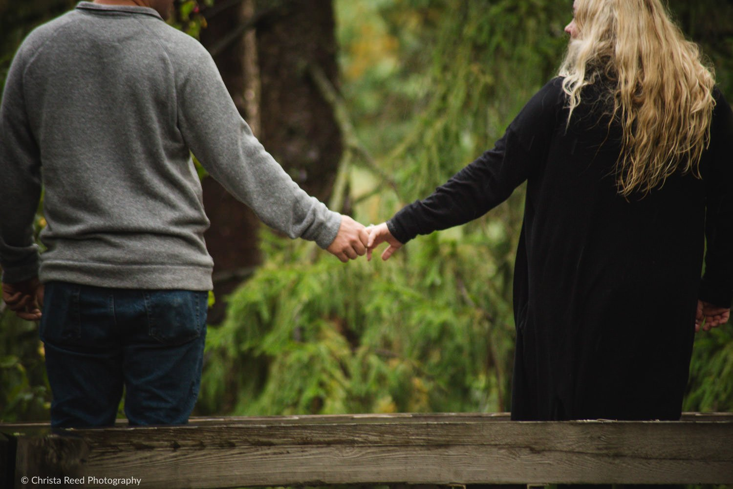 a couple holds hands for their chaska engagement shoot
