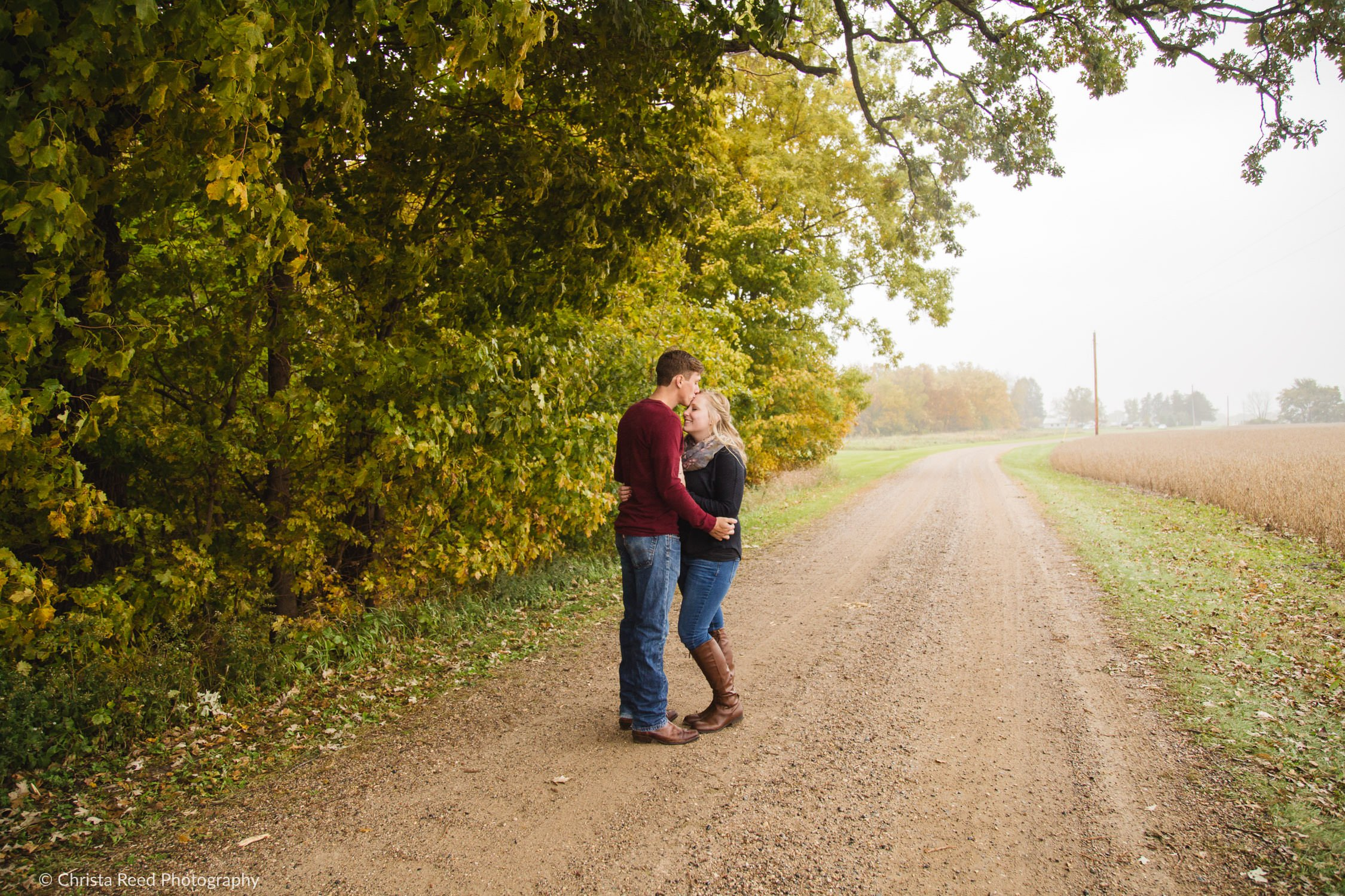 romantic engagement pictures in the country on a dirt road.