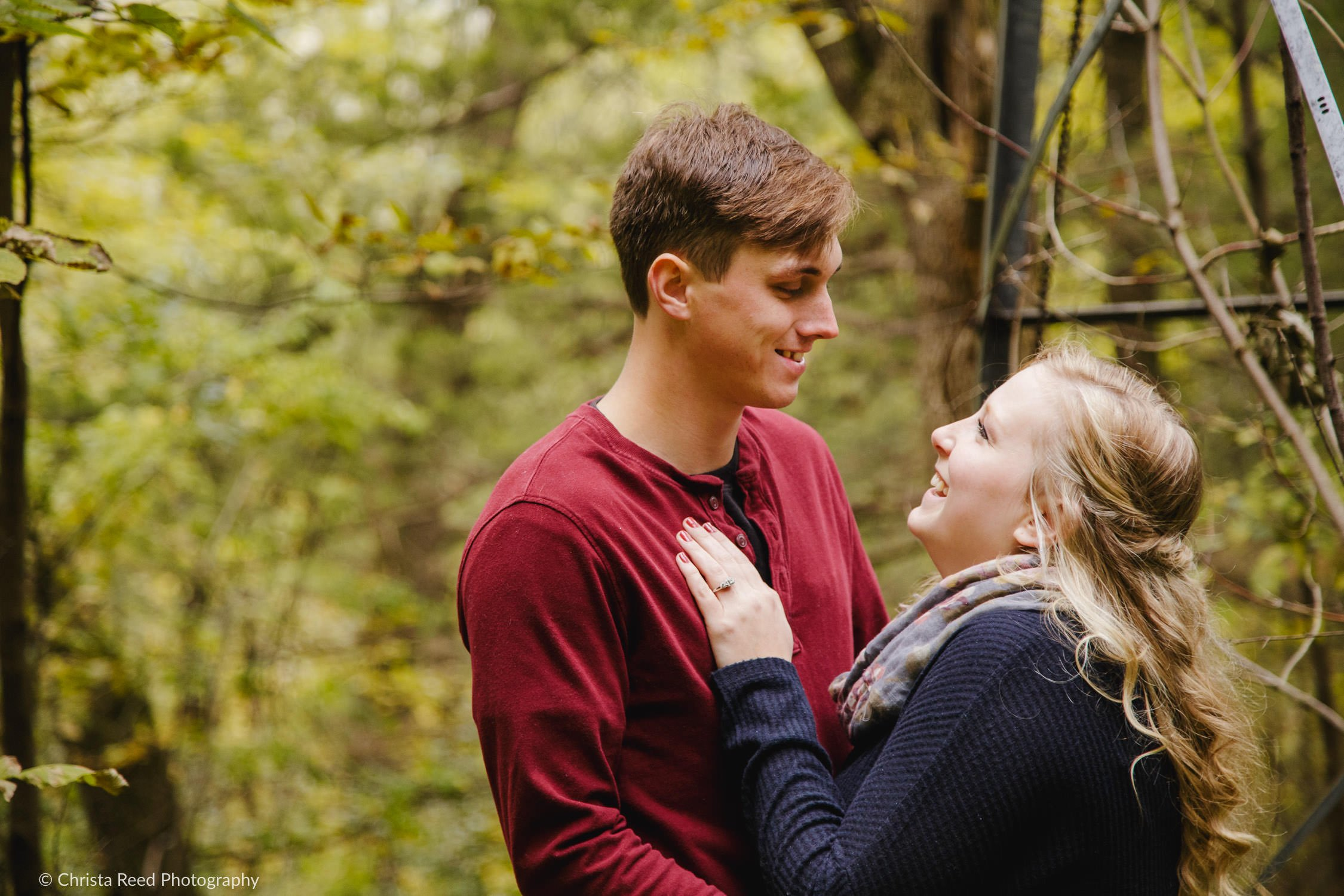 unposed engagement pictures in the woods