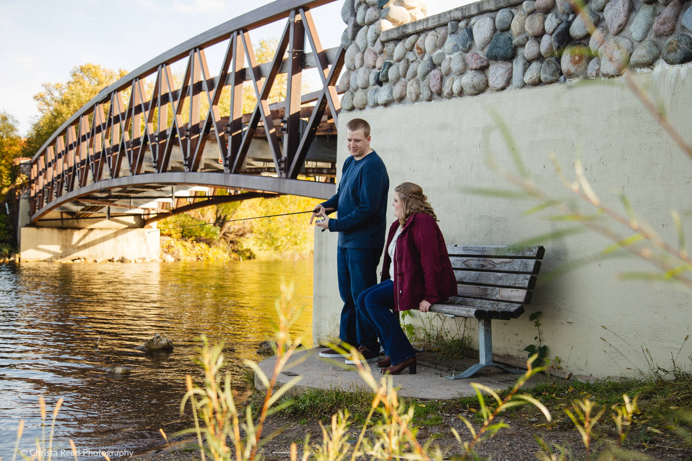 a couple goes fishing for their white bear lake engagement shoot