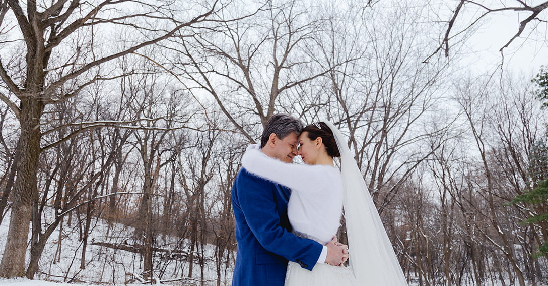 a couple poses for their winter wedding photography in Minnetonka Minnesota