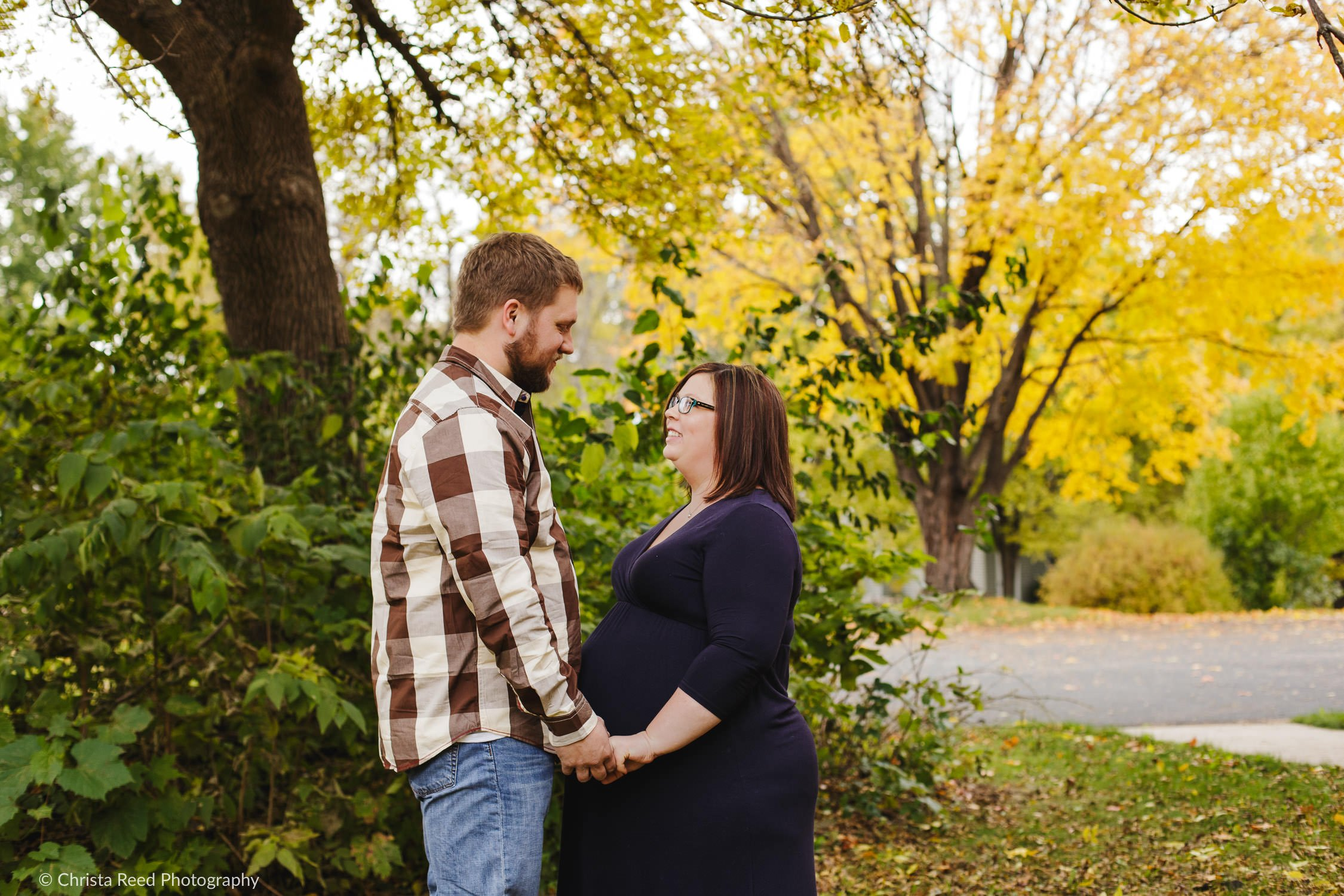 a couple holds hands for their Belle Plaine Mn Maternity Photography
