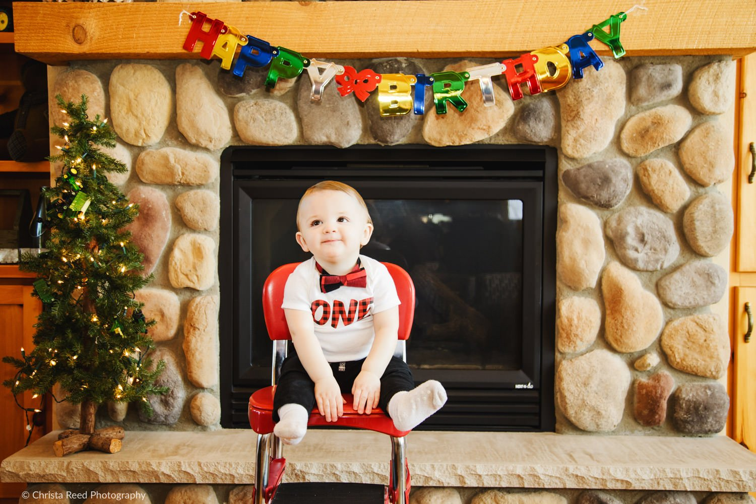 first birthday photoshoot at home by the fireplace
