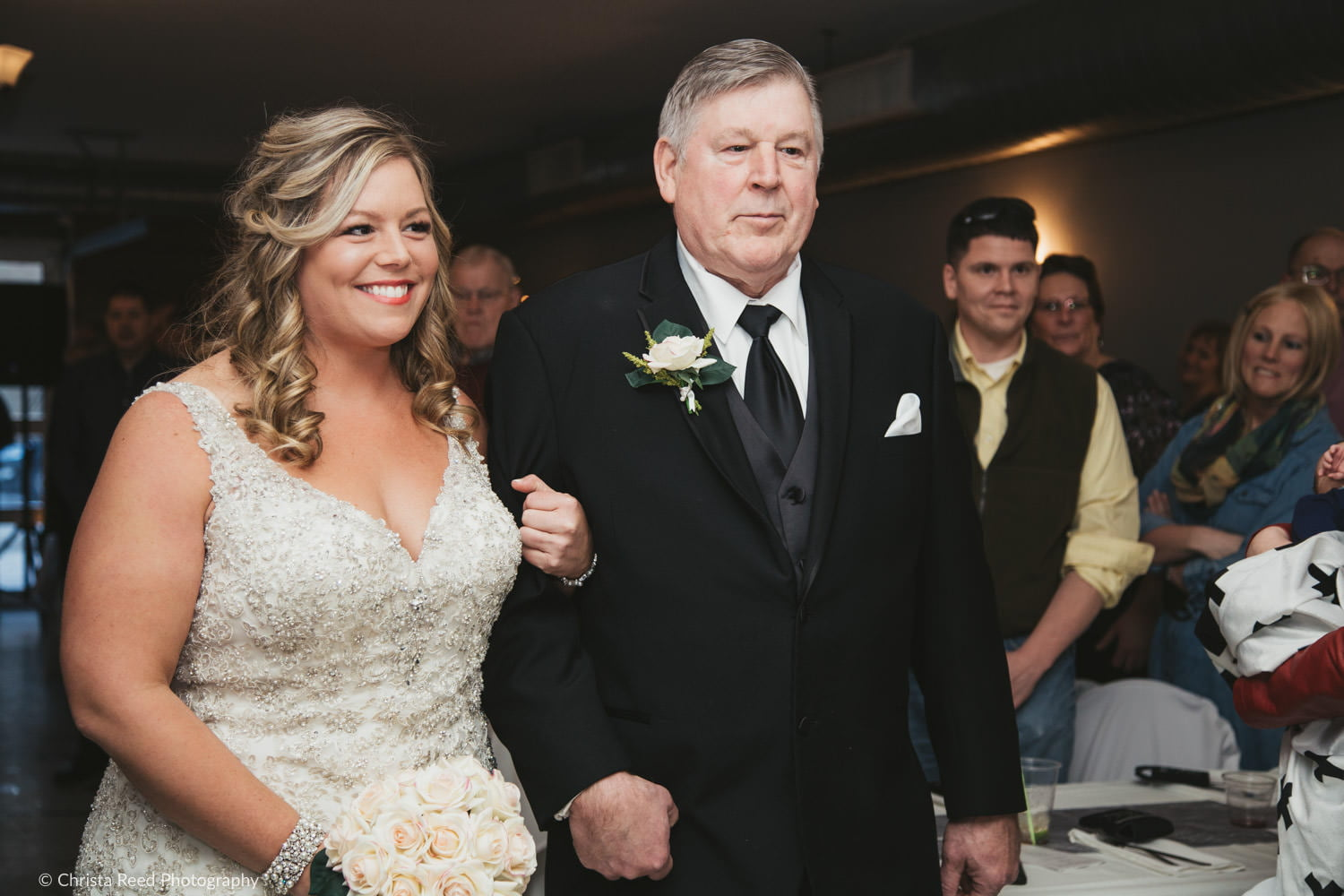 a bride walks down the aisle with her father on her wedding day in Henderson Minnesota