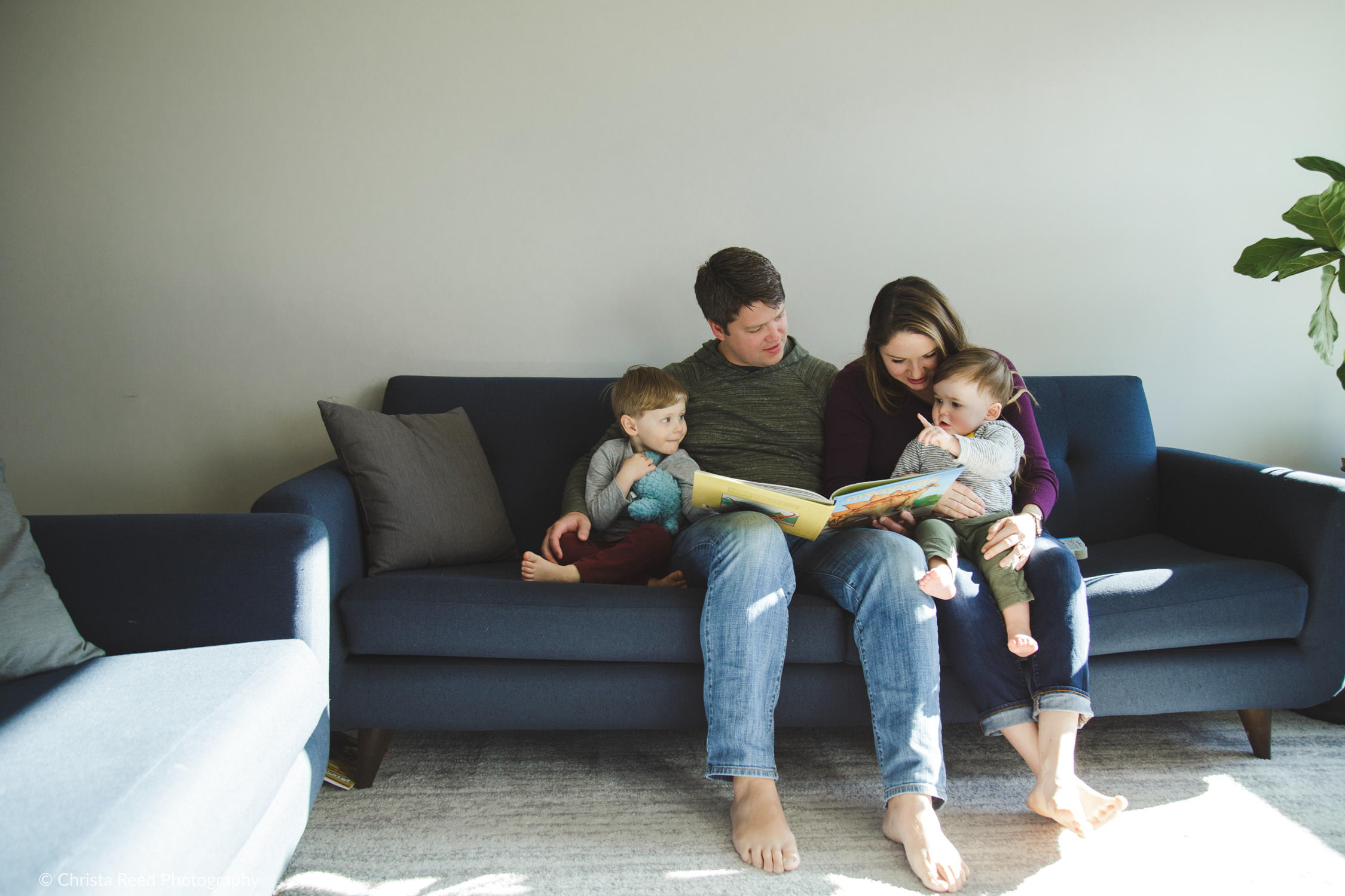 reading at home during lifestyle family photography in Waconia