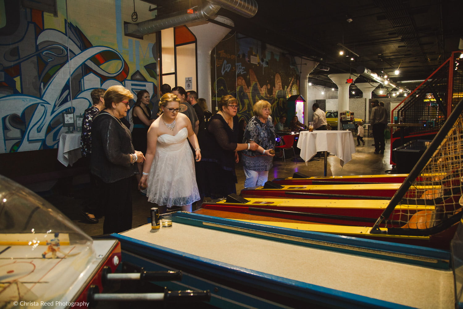 playing skee ball at a Can Can Wonderland wedding