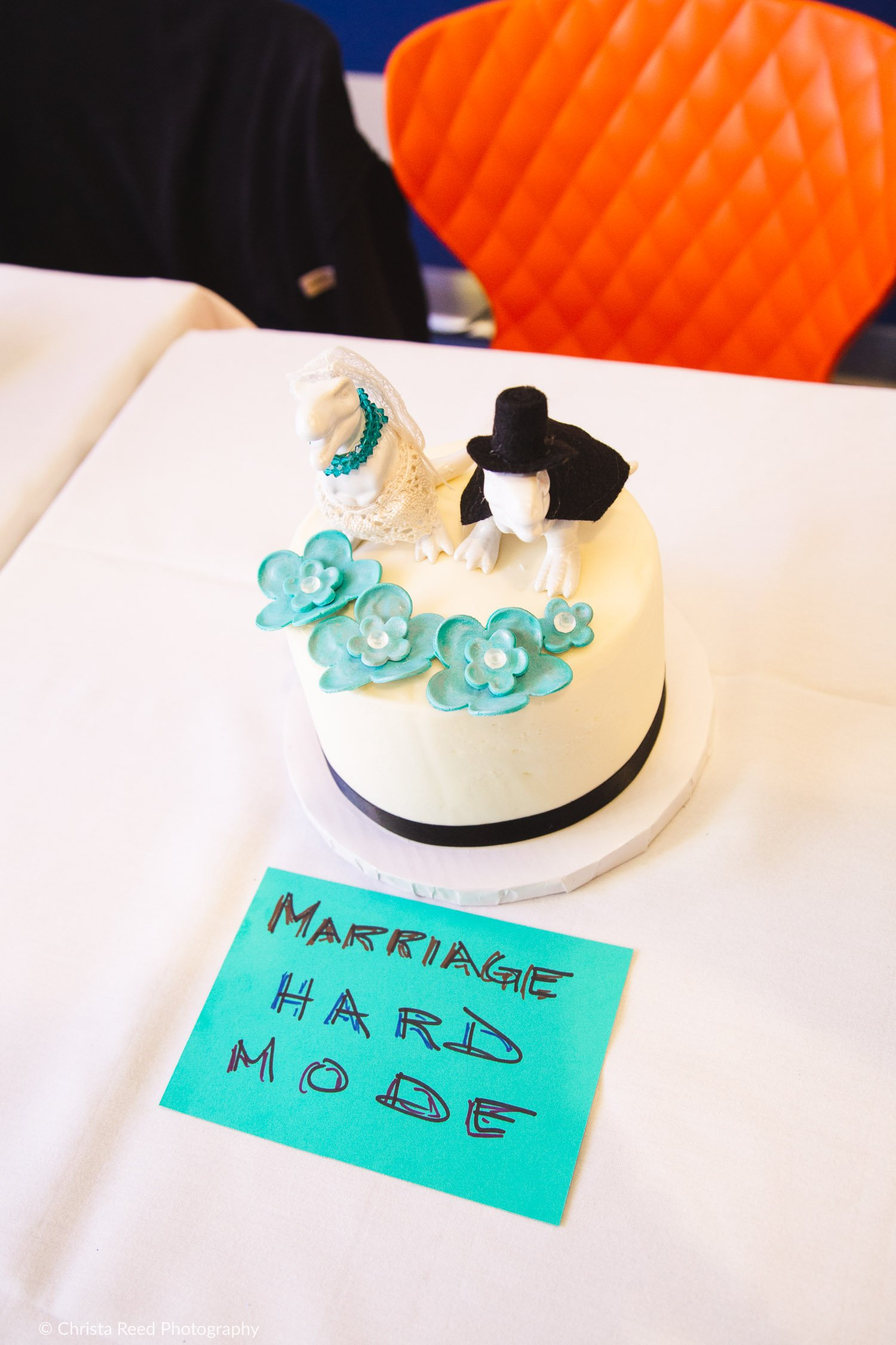 A gamer wedding cake with dinosaurs