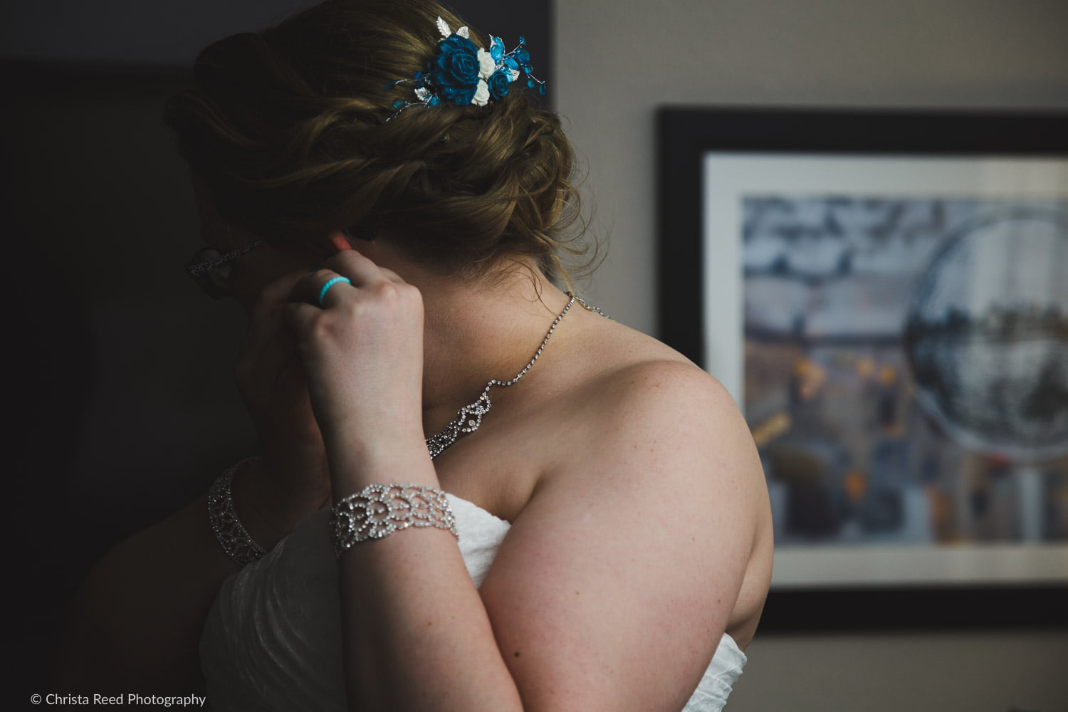 a wedding details picture with jewelry
