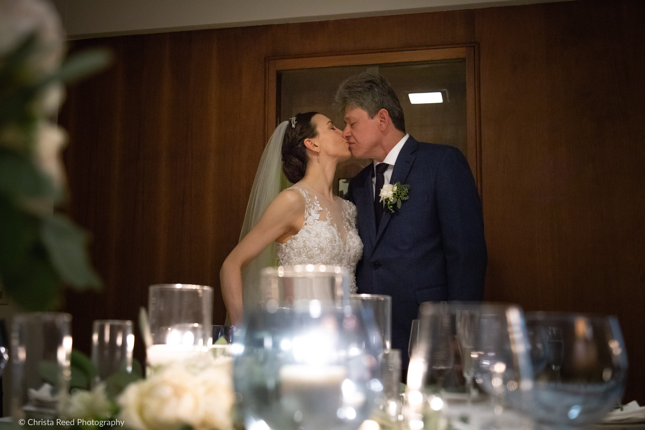 a couple kisses at their Minnetonka winter wedding