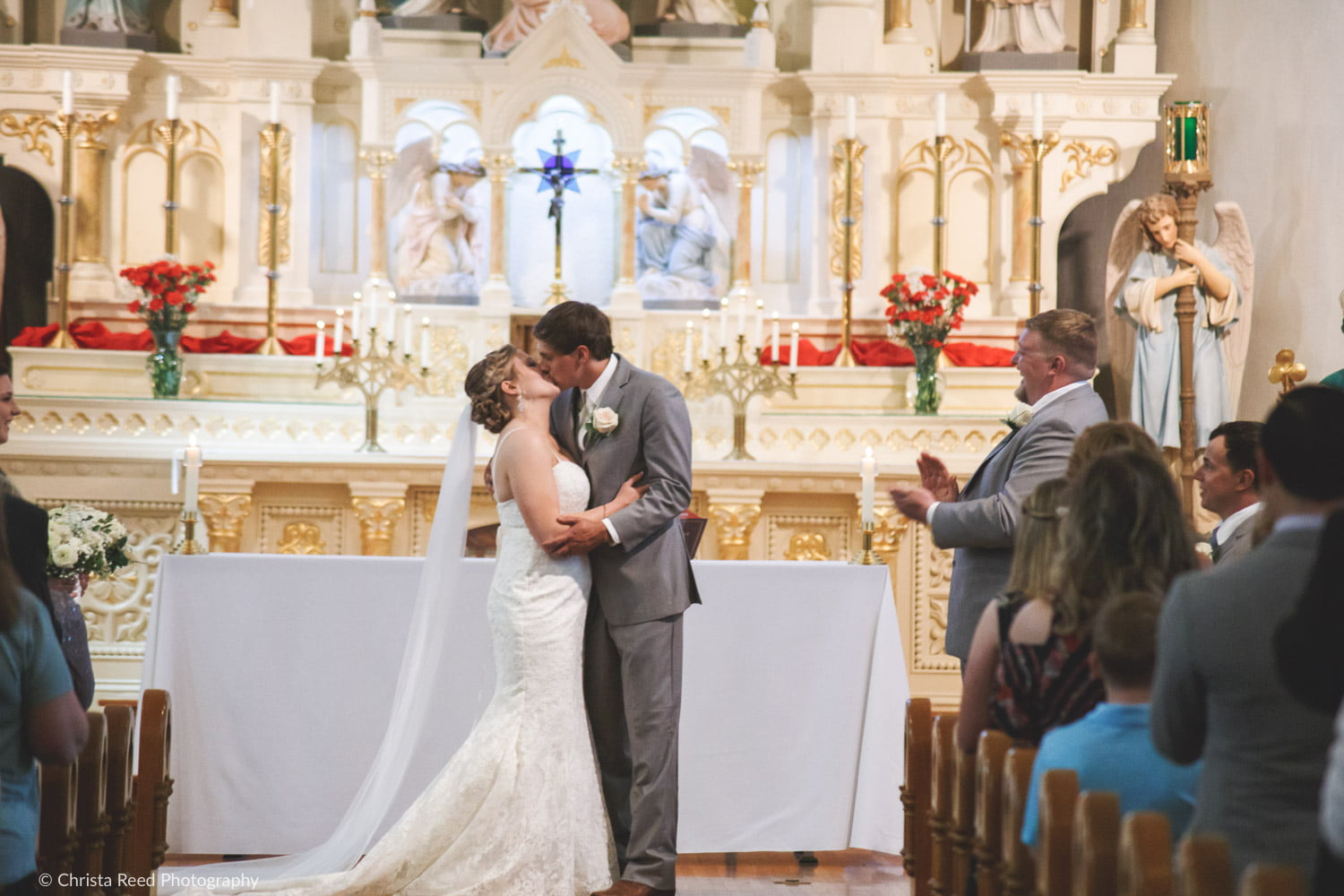 the first kiss during a wedding ceremony at Our Lady of the Prairie in Belle Plaine Minnesota