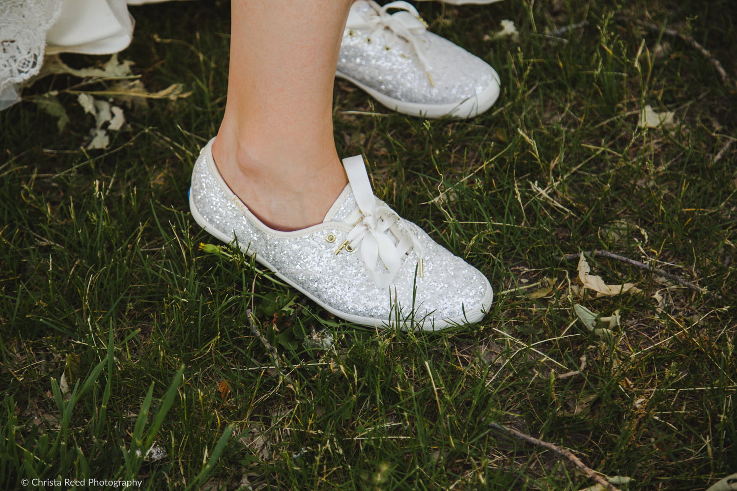 a pair of fun and sparkly bridal tennis shoes