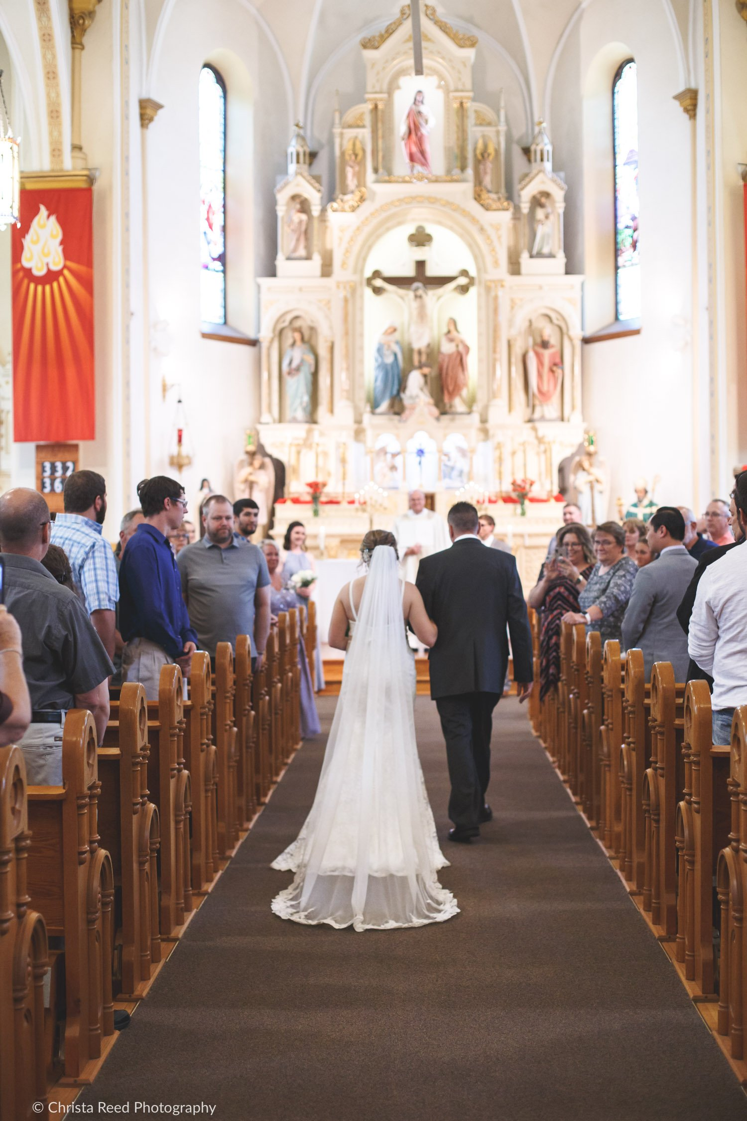 walking down the aisle at our lady of the prairie catholic church in belle plaine