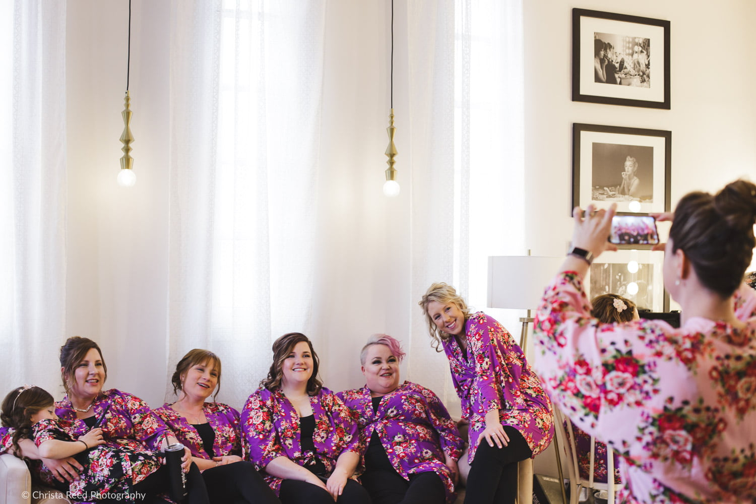 bridesmaids wearing matching pink floral robes at the capitol room