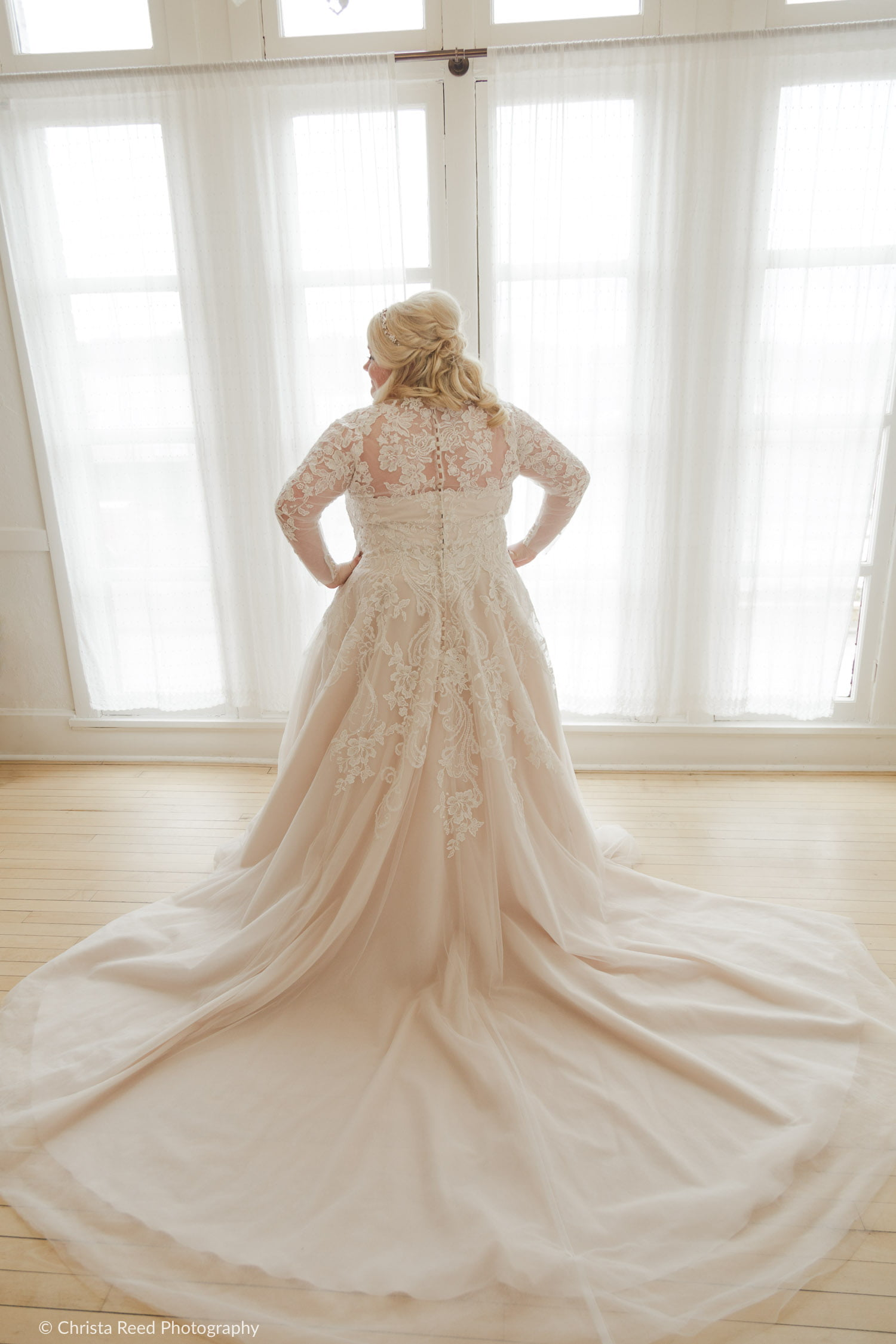 plus size wedding dress with vintage lace long train and buttons down the back