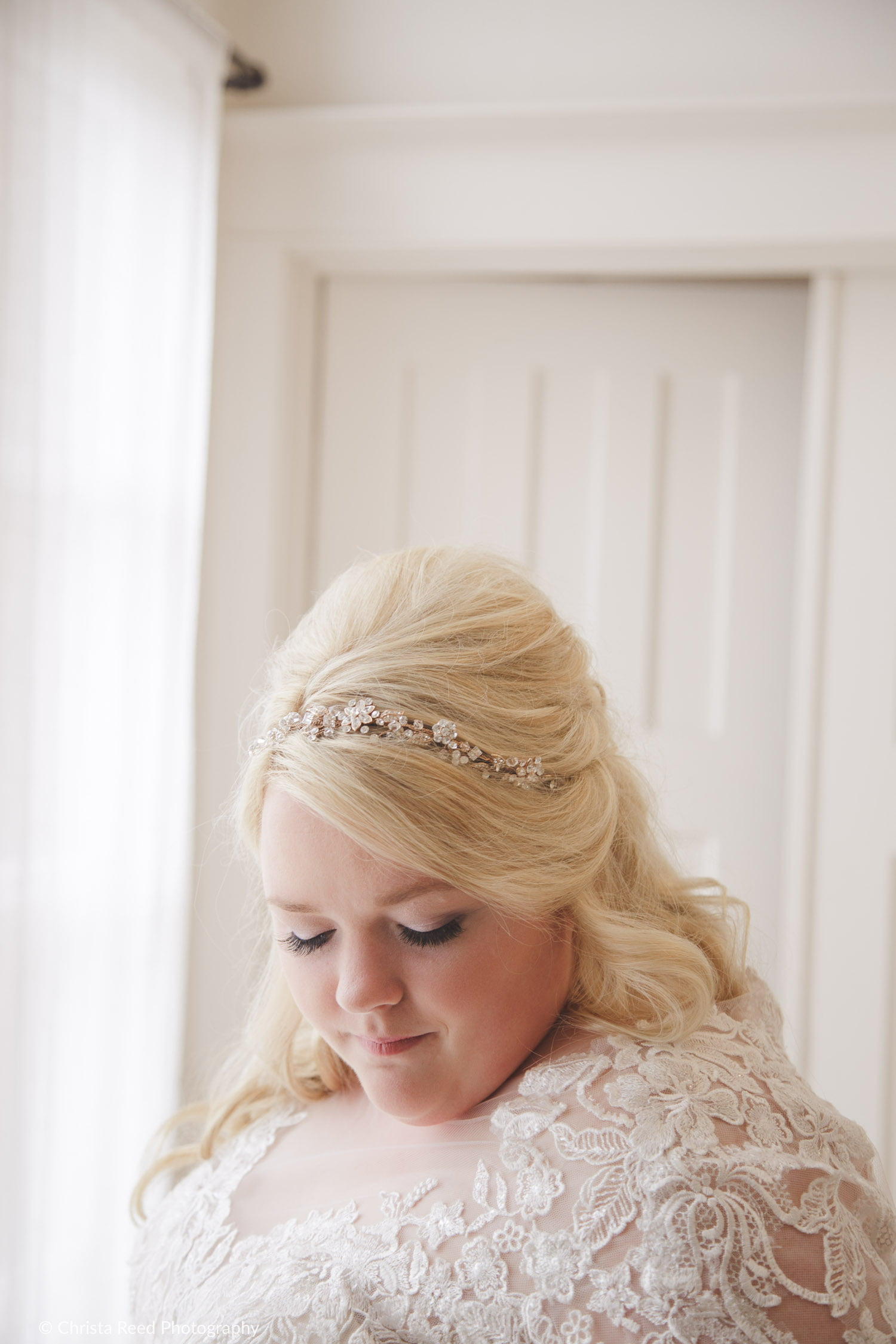 plus size wedding hair with a half up do and crystal flower crown